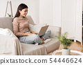 Teen Girl Surfing Internet on Laptop Computer at Home 54446624