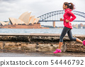 Runner fit active lifestyle woman jogging on Sydney Harbour by the Opera house famous tourist 54446792