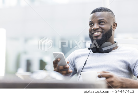 Portrait of smiling african american man using cellphone 54447412