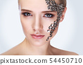 Fashion portrait of a beautiful woman with long eyelashes and piercing eyes. The idea of an unusual 54450710