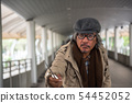 Old man attack with knife in city 54452052
