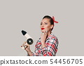 Happy young brunette woman with hair dryer. 54456705
