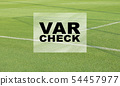 VAR CHECK text on empty football soccer field with 54457977