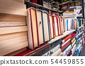 Piles of old books on a stall. 54459855
