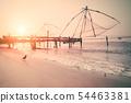 Fishing nets silhouette at sunset. Cochin, India 54463381