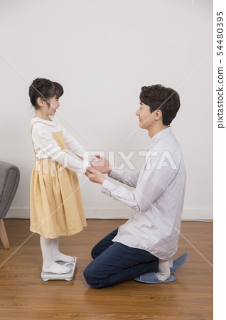 Parenting, childhood and family life concept photo 273 54480395