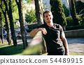 Portrait of Man Training With Slackline In City Park 54489915