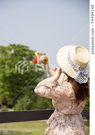A woman taking a self-portrait 54494148