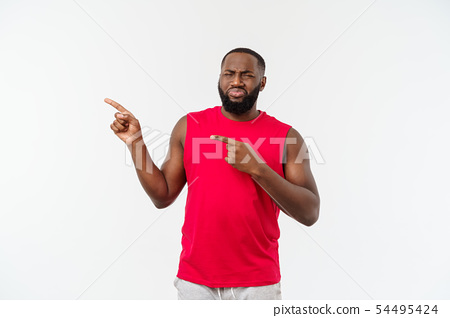 African-American man with sport wear pointing fingers with unhappy emotion. 54495424