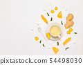 Composition with cup of tea, fresh orange, mint 54498030