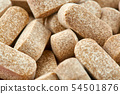 Close-up photo of many brown pills. Medicine 54501876