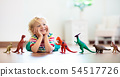 Child playing with toy dinosaurs. Kids toys. 54517726
