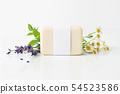 Closeup of hand made herbal soap bar in blank paper label package. Mint leaves, lavender and 54523586