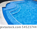 Blue surface water in the pool. Edge the pool. 54523744