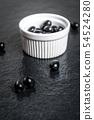 Black olives on black stone 54524280