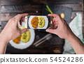 Man taking photo of Chicken steak or schnitzel 54524286
