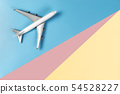 Toy plane is traveling the world concept on blue 54528227