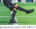 Soccer boy is training kicking the ball in soccer 54528517