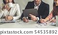 Businessman and businesswomen working in office. 54535892
