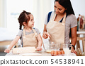 Mother and daughter cooking 54538941