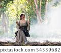 Beautiful Woman in local dress sitting on swing 54539682