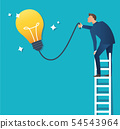 a man on ladder pointing at yellow light bulb 54543964