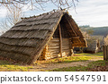 Old rural hut with a thatched roof 54547591