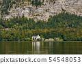 Church in the village at Lake Hallstatt under a 54548053