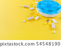 different medicines for one week and a pills box  54548190