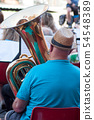 Portrait of tuba player with hat on back view 54548389