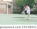 Children are wearing slippers playing football 54548441