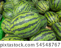 watermelon stacked on the marketplace 54548767