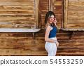 Portrait of well-built stylish girl in midi skirt 54553259
