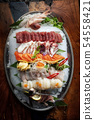 Sashimi from different types of fish on ice. Top 54558421