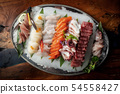 Sashimi from different types of fish on ice. Top 54558427