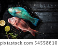Sea delicacies. Fresh seafood. Parrot fish 54558610