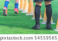 Children feet with soccer boots training on 54559565
