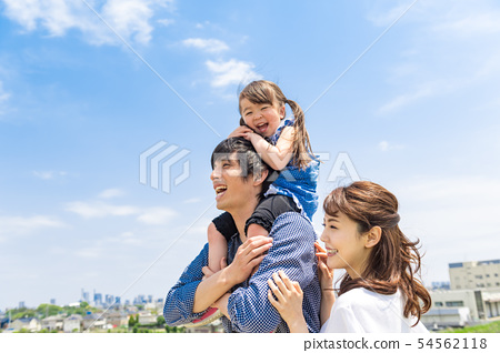 Family, blue sky, shoulder car, looking up 54562118