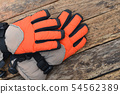 Winter gloves on natural wooden table  54562389