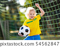 Brazil football fan kids. Children play soccer. 54562847