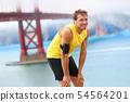 Running man - male runner resting in San Francisco 54564201