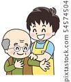 Male carer giving assistance to elderly men 54574504