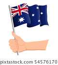 Hand holding and waving the national flag of Australia. Fans, independence day, patriotic concept 54576170