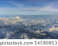 Above clouds, view from pilot cabine airplane. Blue sky, white clouds with magic and soft sun light. 54580853