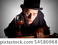 Man dressed up as Dracula for the halloween 54580968