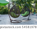 Hanging wicker chairs at the recreation center in the summer. Concept of recreation and leisure 54581978