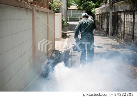 Man's fogging to eliminate mosquito 54582805