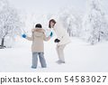 Asian mother and her son playing snow in the park 54583027
