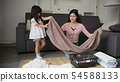 Family concept. Mother and daughter are folding 54588133