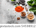 Healthy vegan food on a concrete background  54598912